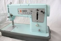 ice blue vintage singer sewing machine  I have this..I just need someone to teach me how to use it!!