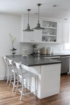 This is it!!! White cabinets, subway tile, quartz countertops by ivy