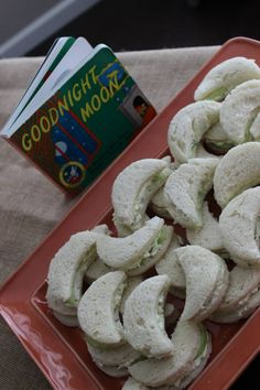 """Moon shaped sandwiches to go with the book, """"Goodnight Moon"""". Simple cucumber sandwiches cut out with a crescent moon cookie cutter."""