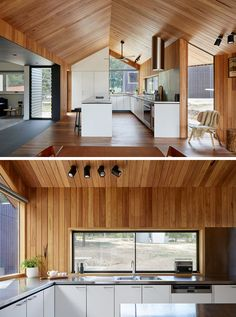 This modern wood-lined interior houses a new white kitchen with stainless steel countertops. #WhiteKitchen #StainlessSteelCounter #GabledCeiling #WoodInterior