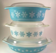 I've had this blue on white snowflake casserole dish for a while, but finally found some white on blue to go with it today. With lids too. Yay! :)
