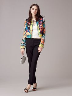 Melding our custom floral Bournier print in peach, acid yellow, and black, this cropped, collarless wool and silk jacket features a sharp, tailored cut with clean seam detailing throughout, and a silver-tone, exposed zip in the front.