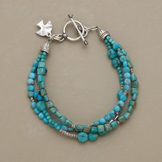 Jewelry Turquoise MEDLEY OF TURQUOISE BRACELET -- Different shapes and shades of turquoise harmonize with Thai silver beads. The bracelet's three strands secure with a sterling silver toggle. Wire Jewelry, Jewelry Crafts, Beaded Jewelry, Unique Jewelry, Jewelery, Jewelry Bracelets, Silver Jewelry, Jewelry Design, Silver Beads
