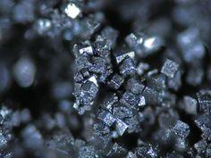 Bornite, Cu5FeS4, Las Cruces Mine, Gerena, Seville, Andalusia, Spain. Pseudocubic bornite crystals. Fov 2 mm. Copyright: © 2013-C. Menor-Salvan