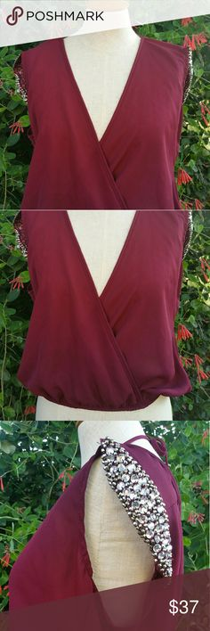 Stunning Charlotte Russe Top Beautiful bold burgundy top, beautiful diamond rhinestone details on the shoulders, ties at the neck. Charlotte Russe Tops Blouses