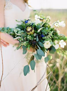 Such a beautiful bouquet: http://www.stylemepretty.com/little-black-book-blog/2015/05/29/rustic-elegant-wedding-inspiration-at-the-dixie-gin/ | Photography: Brandi Smyth - http://brandismythphotography.com/
