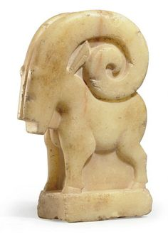 A SOUTH ARABIAN ALABASTER IBEX   CIRCA 1ST CENTURY A.D.   Standing on a high rectangular integral plinth, the plump body with short legs, the hooves incised, with long curving underslung horns, the triangular ears projecting below, bulging pellet eyes and a square beard, with a raised medial line vertically along the muzzle  13 1/8 in. (33.3 cm.) high