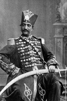 Nasser al-Din Shah Qajar 1831 – 1896 King of Persia from 17 September 1848 to 1 May 1896 when he was assassinated. He was the son of Mohammad Shah Qajar and Malek Jahān Khānom and the third longest reigning monarch in Persian history after Shapur II of the Sassanid dynasty and Tahmasp I of the Safavid Dynasty. Nasser al-Din Shah had sovereign power for close to 50 years and was also the first Persian monarch to ever write and publish his diaries. (Wearing a diamond studded  uniform).
