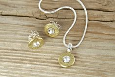 Winchester 40 Caliber Bullet Earrings Necklace Gift Set Sterling Silver. $39.95, via Etsy.