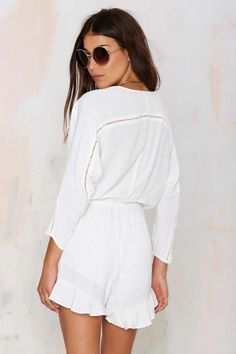 Good vibes only in the Feelin' Myself white crepe romper!