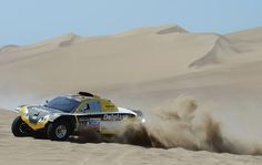 Regis Delahaye and co-pilot Alexandre Winocq of team Buggy MD Rallye compete in the special stage during day one of the of the 2013 Dakar Rally on January 5, 2013 in Pisco, Peru.