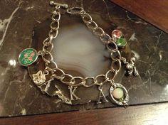 Alpha Kappa Alpha inspired costume quality charm bracelet.   Email Nellye56@yahoo.com or go to Nellye56 on Etsy.  Similar Delta Sigma Theta and Zeta Phi Beta bracelets also