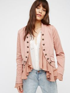 Romantic Ruffles Jacket | A femme update on a menswear-inspired piece. Etched buttons adorn the front of this structured jacket while romantic ruffles flow from the inside and out of the sleeves creating a softly layered look. Small back belt detail. Slightly stretchy fabrication for an ultra comfy fit.