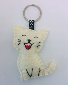 This cute cat keychain is made with wool felt. I have some of these ready, but you can order it in any other color, please write me a mail about your custom order, or choose at the right side. Perfect as a little gift for a friend, as Christmas stuffing, or just a cute accessory for