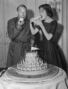 Audrey and Maurice celebrate Chevalier's 68th birthday on the set of Love in the afternoon, 1957