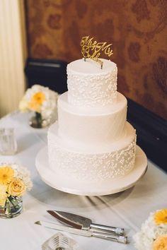 Classically elegant cake created by I Do! Wedding Cakes.  Photographer: Toronto Wedding Studios