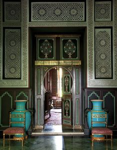YSL's Marrakech house; Villa Oasis. Designed by Bill Willis & Jacques Grange.  The view through a pair of painted doors into the library. Photography by Oberto Gili.