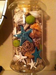 Apothecary jar filled with beach decor