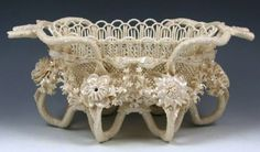 An Irish Belleek, Porcelain, Rathmore Pattern Four-Strand Basket with Extremely Intricate and Highly Detailed Applied Flowers, Decoration in Mother-of-Pearl Lustre. Circa 1921-1954
