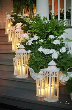White lanterns and white flowers in white baskets = sweet porch. Bride Bop
