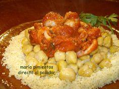 Cuscus con garbanzos y calamares en salsa de tomate