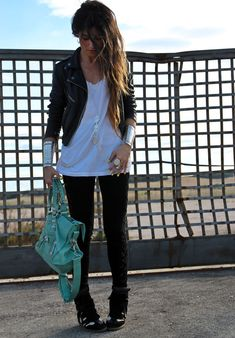Not a fan of those alien bracelets, but I do love a colorful bag with a rocker chick look :)