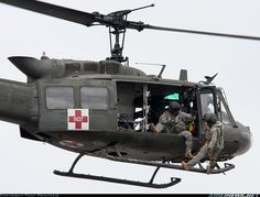 This is a Huey helicopter that they used to rescue people. One of the soldiers in my story was a medic on this helicopter. Us Military Aircraft, Military Helicopter, Military Vehicles, Bell Helicopter, Helicopter Pilots, Military Service, Military Art, Army Medic, Vietnam War Photos