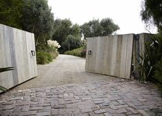Patrick Dempsey Malibu garden gates driveway cobblestone ; Gardenista