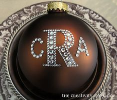 monogrammed rhinestone ornaments made with stickers from hobby lobby