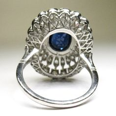 Period: Art deco (1920-1935) Composition: Platinum Stones: 1 natural oval cut sapphire that weigh 1.50ctw. 45 Old mine cut diamonds of H-VS2 quality that weigh