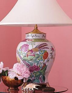 Bring any accent table to life with the Quail Table Lamp that boasts a bright and eye-catching botanical design complimented by rich brass accents.