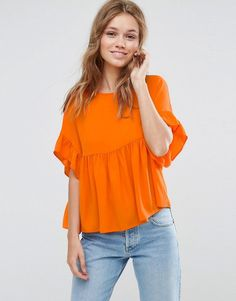 Buy it now. ASOS Smock Top with Ruffle Sleeve - Orange. Top by ASOS Collection, Lightweight woven fabric, Textured finish, Round neck, Ruffle trim, Button-keyhole back, Regular fit - true to size, Machine wash, 100% Polyester, Our model wears a UK 8/EU 36/US 4 and is 173cm/5'8 tall. Score a wardrobe win no matter the dress code with our ASOS Collection own-label collection. From polished prom to the after party, our London-based design team scour the globe to nail your new-season fashion…