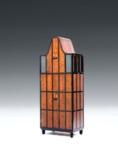 ARTS & CRAFTS SCHOOL, VIENNA EXTRAORDINARY CABINET solid birch wood and birch wood veneer, 4 doors at the front, 2 lateral top-hinged doors with glass panes; interior: pear wood stained black, 11 drawers, 4 bottom-hinged doors and 2 shelves H 185 cm, W 72 cm, D 45 cm 65000€
