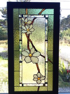 Stained glass dogwood flower panel with bevels. Walnut wood frame.