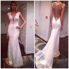 Beautiful, love the shape & cut outs of this dress.