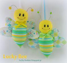 Το τυχερό κουμπί: Τυχερές μελισσούλες και Πασχαλινές λαμπάδες