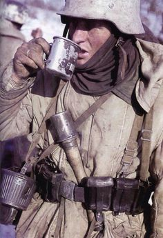 German takes a cup during a lull on the Eastern Front