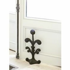 The fleur de lis doorstop. Probably the prettiest way to dress up a door I can think of. Or buy two and use them as bookends for tall coffee table books. Tall Coffee Table, Chandelier Lamp Shades, Mantle Piece, Door Stopper, Ballard Designs, Home Accents, A Table, Door Table, Home Kitchens
