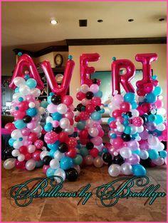 Whimsical name balloon Towers.