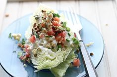WEDGE SALAD -- Iceberg lettuce w/ blue cheese, bacon, green onion and tomato.  (Don't forget the fresh cracked pepper.)