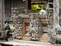 Cat performing ritual of cleansing at Taman Ayun Temple.