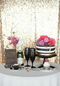 Fresh flowers can pop against shimmery backgrounds and black and white details for winter parties!