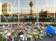 This photo shows another memorial for the MH 17 victims in front of an airport.