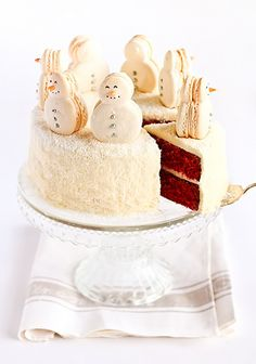 Red Velvet Snow Cake with Snowman Macarons by raspberri cupcakes, via Flickr
