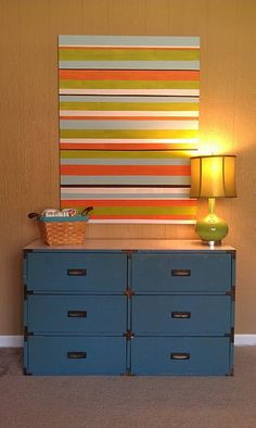 Use fabric or section of wallpaper as wall art