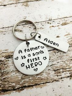 Hand+stamped+personalized+dad+keychain  This+hand+stamped+keychain+is+hand+stamped+with+A+father+is+a+sons+first+hero.++It+comes+personalized+with+childrens+names.+  Additional+tags+can+be+bought+from+the+drop+down+menu.+  Great+Father's+Day+gift+for+a+dad+or+stepdad!+Circle+measures+approximatel...