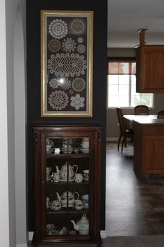 My client's mom made the beautiful doilies, they were framed strategically on a dark brown matte. The antique dresser below holds all of her mom's treasures.