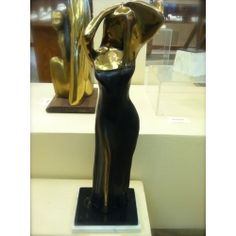 Alfred Tibor Sculpture Combing Hair, Bronze. Available at Argo & Lehne Jewelers.