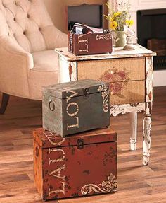 Vintage Live Love Laugh Trunk Trio are accent pieces that make incredible storage. Distressed boxes are decorated in earthy tones with charming scrollwork. Hing