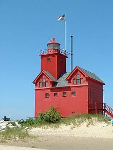 The Holland Harbor Light, known as Big Red, is located in Ottawa County, Michigan at the entrance of a channel connecting Lake Michigan with Lake Macatawa, and which gives access to the city of Holland, Michigan. (wikipedia)